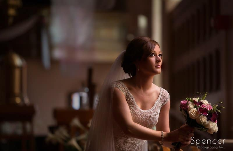 bride holding wedding bouquet in sanctuary at St. Paul's