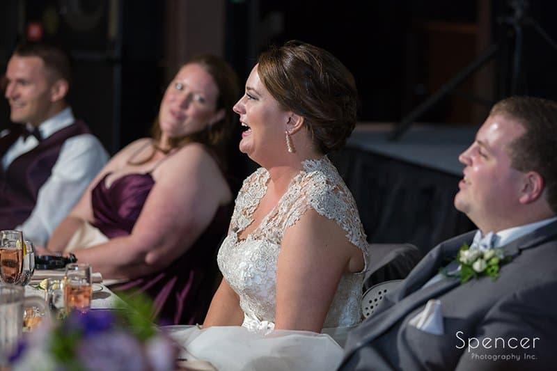 bride reaction to best man speech at wedding reception at Happy Days Lodge