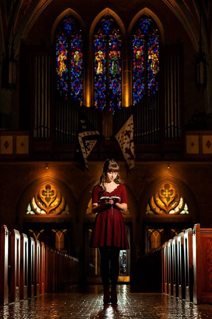artistic senior picture in a church