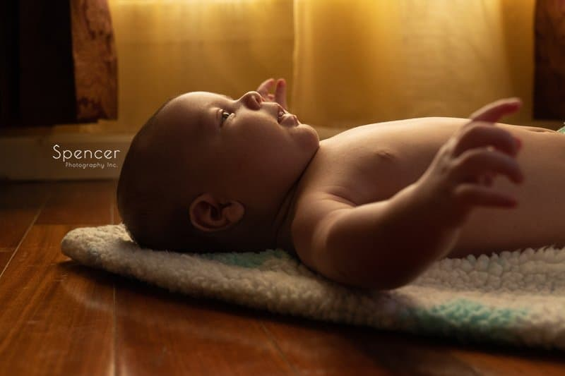 baby laying on a floor
