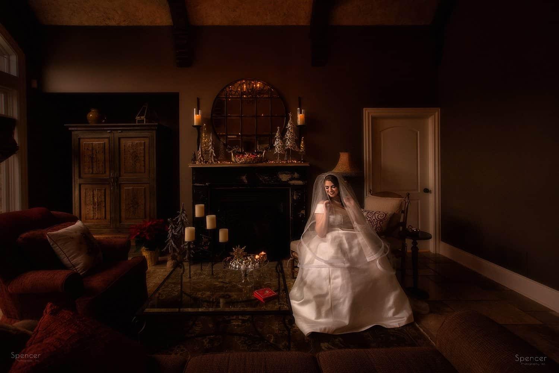 bride adjusting her veil before her winter wedding in Cleveland