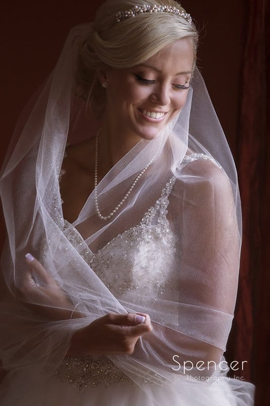 traditional wedding picture of bride holding veil