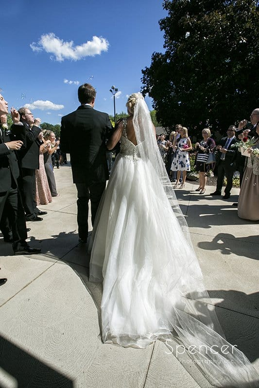 bride and groom exit their wedding ceremony at st barnabas