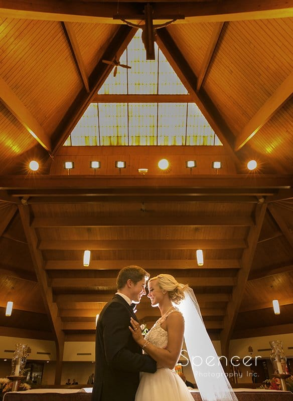 creative wedding picture inside st barnabas church