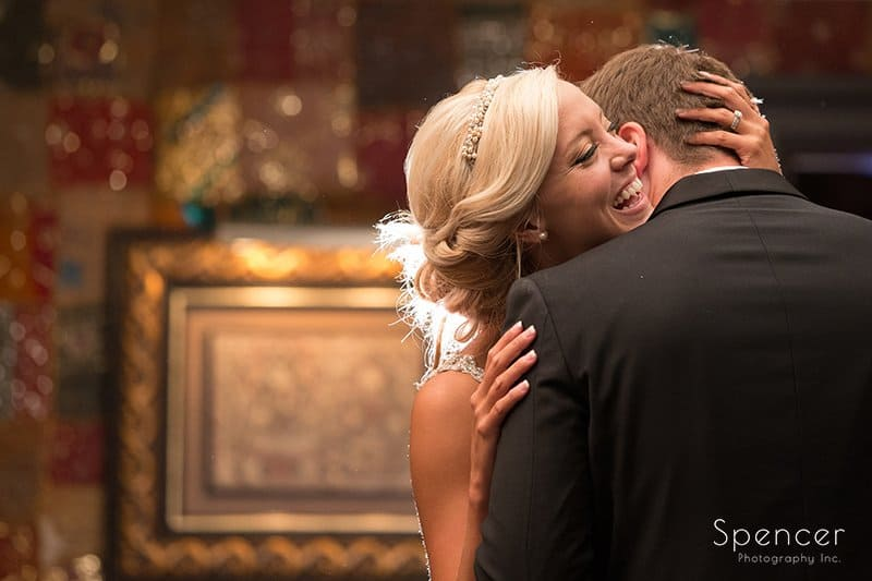 groom kissing brides neck in Foundation Room at House of BLues wedding day