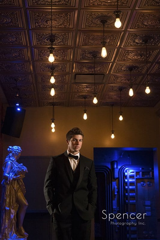 creative wedding day picture of groom in vault at Metropolitan at the 9