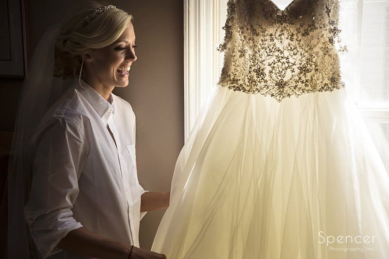 bride grabbing her wedding dress