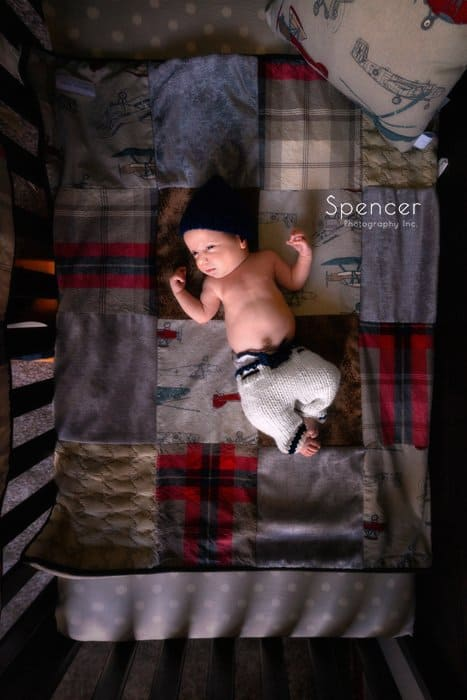 cleveland baby laying in crib