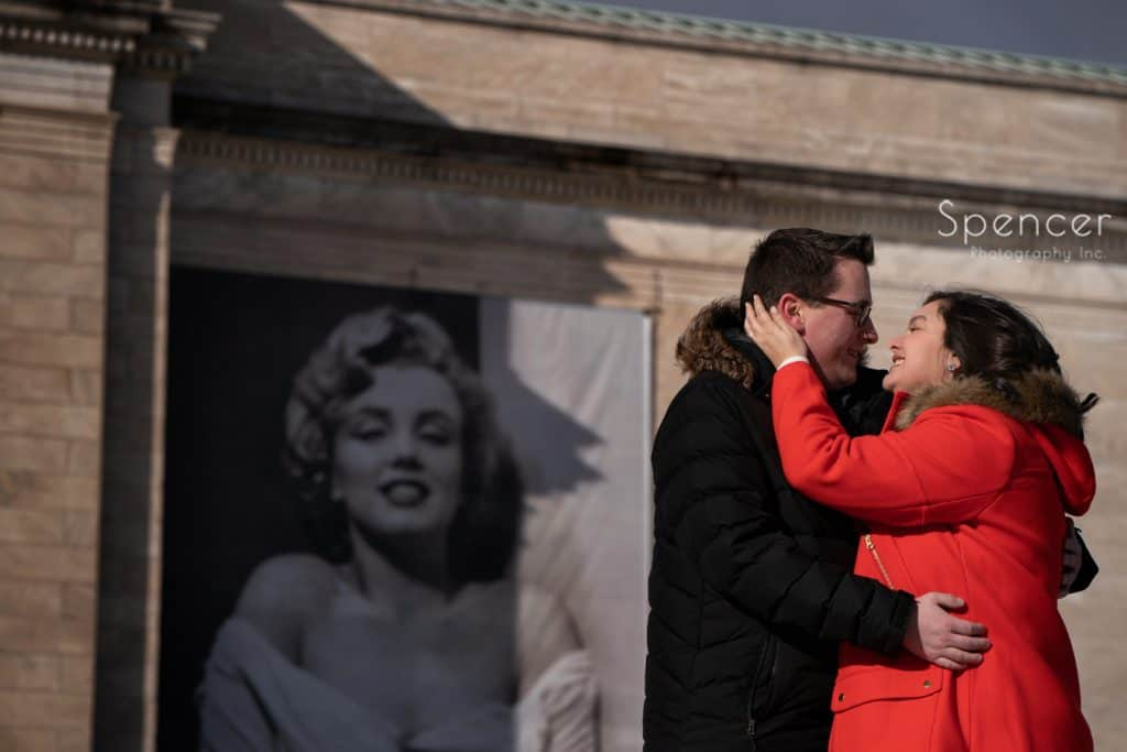 couple kissing during engagement pictures at Cleveland Museum of Art