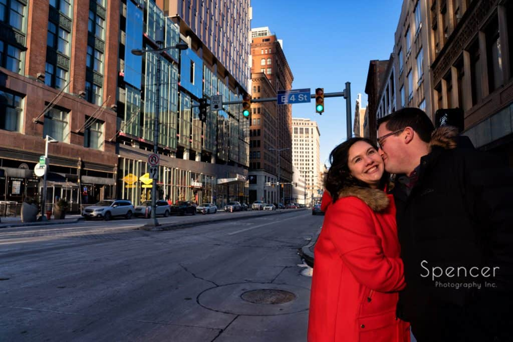 man kissing woman in downtown Cleveland