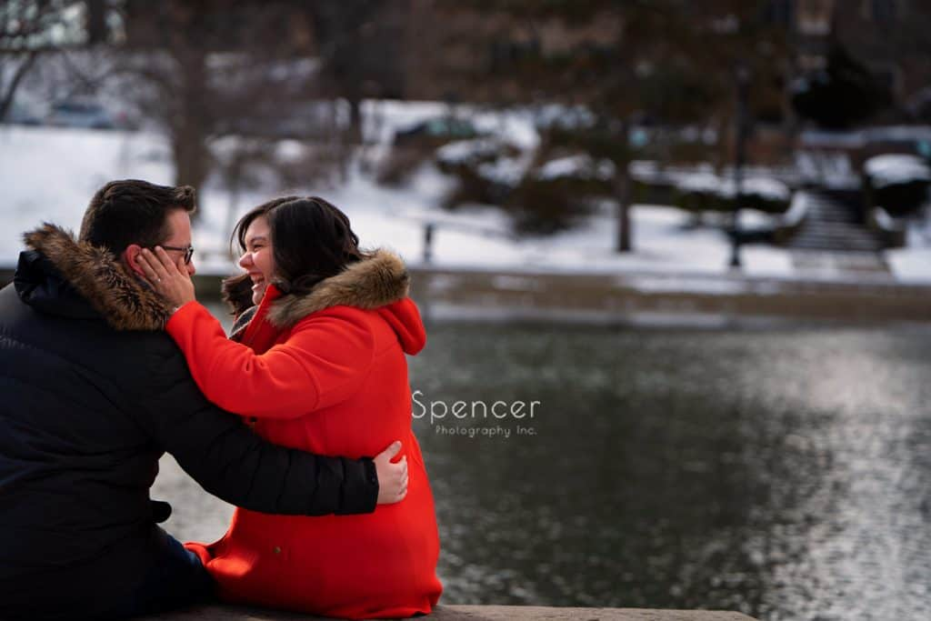 woman holding mans face in engagement pictures at Cleveland Museum of Art