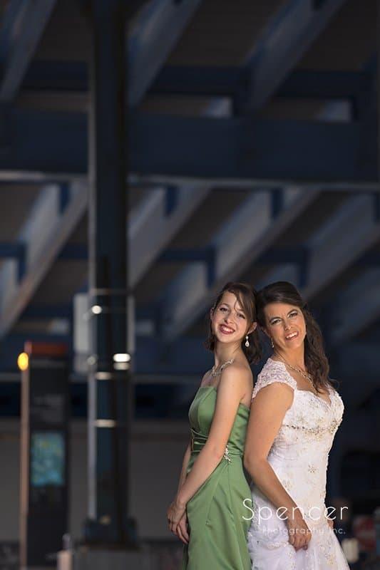 bride and bridesmaid under bridge in Cleveland Flats