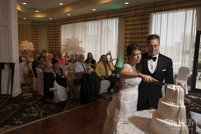 bride and groom cutting wedding cake at Crown Plaza Cleveland