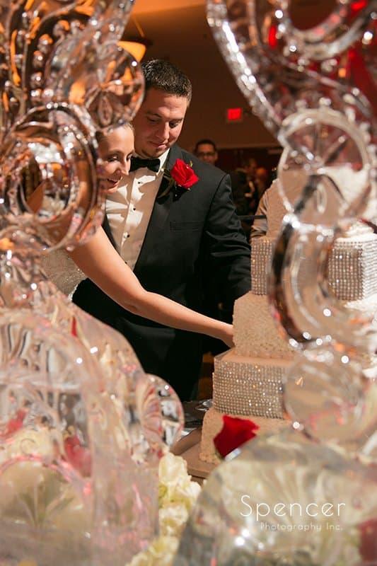 bride and groom cutting wedding cake at Galaxy Restaurant