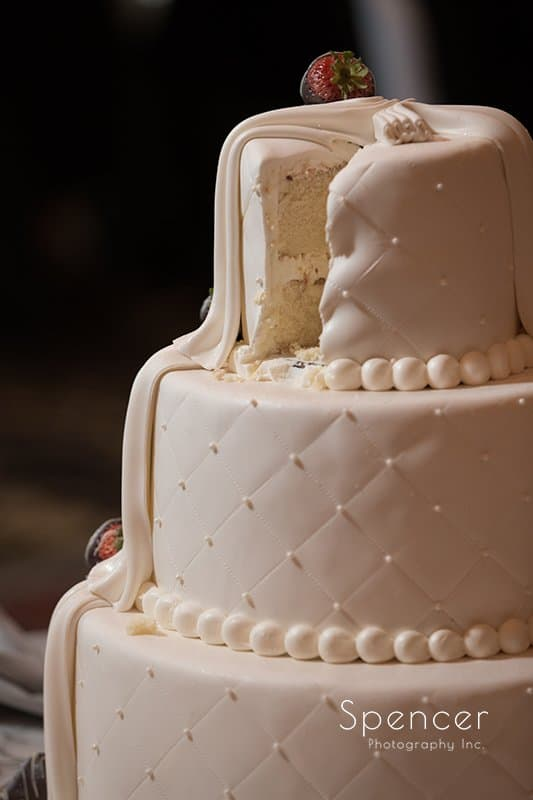 cut wedding cake at wedding reception at Crown Plaza Cleveland