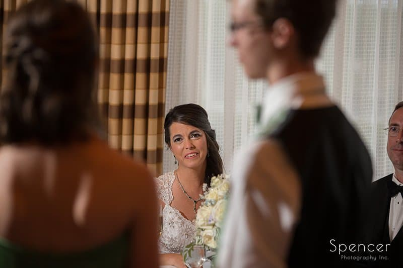 bride listeing to maid of honor speech