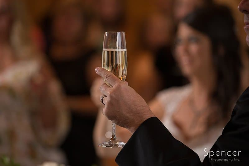 bride and groom toast at their wedding reception at Crown Plaza Cleveland