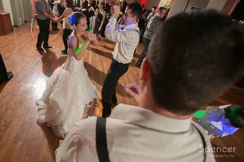 bride dancing at her wedding reception at Galaxy Restaurant