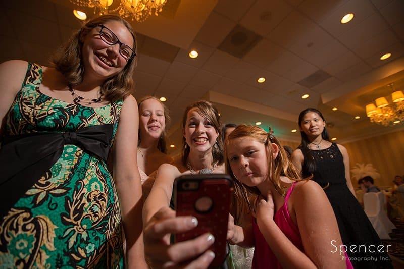wedding guest at wedding reception at Crown Plaza taking selfie