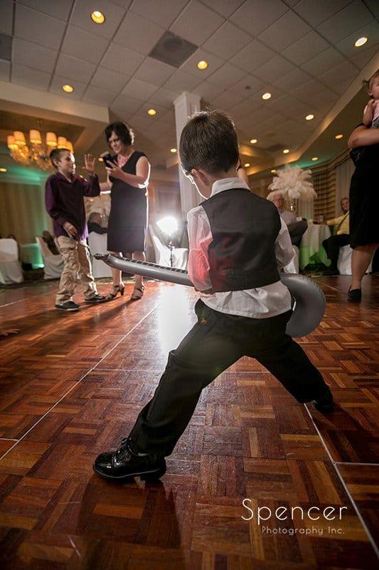 ring bearer dancing at wedding reception at Cleveland Crown Plaza