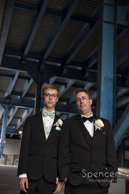 groom and groomsmen under bridge in Cleveland Flats