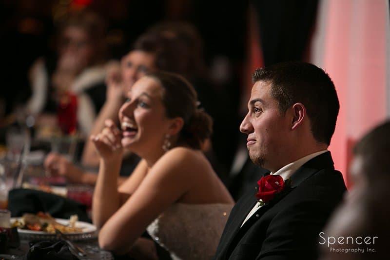 bride reacting to best man speech at Galaxy Restaurant wedding reception