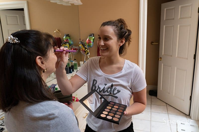 bride helping mom with make-up
