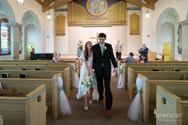 bride laughs as she exits wedding at the Chapel Akron Ohio