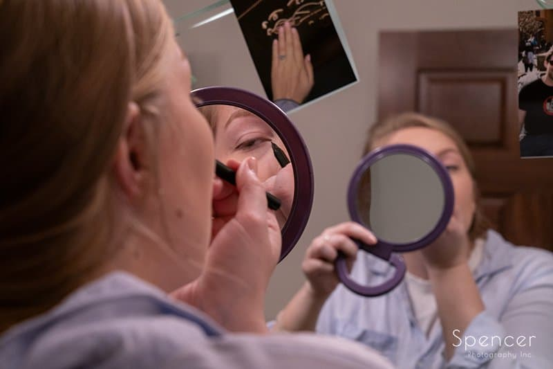 close up of maid of honor applying wedding day make up
