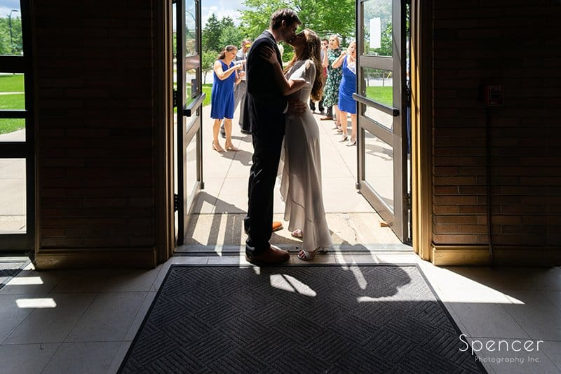 bride and groom kissing after wedding in Akron