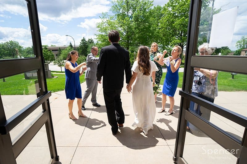bride and groom walking outside wedding ceremony at The Chapel