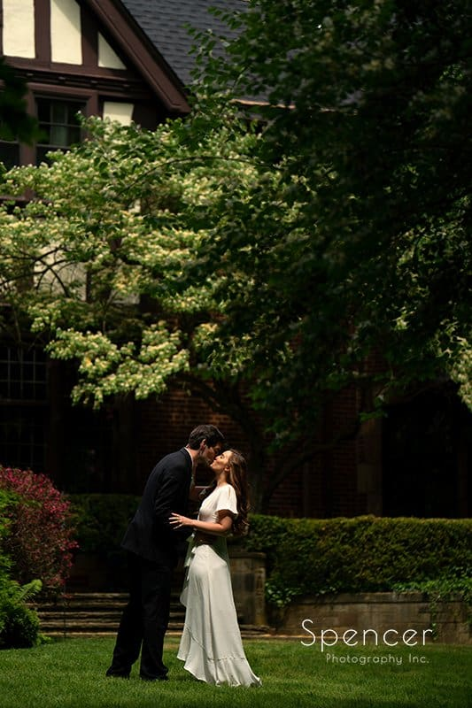 wedding picture of groom kissing bride at O'Neil House Akron