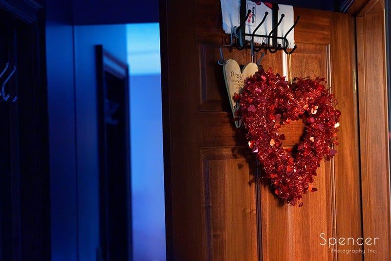 heart hanging on brides door