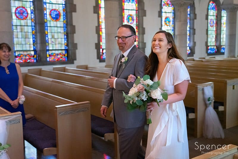 dad walking bride down aisle at Chapel in Akron