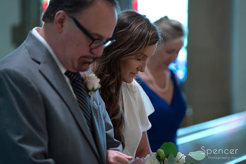 bride standing with dad at wedding ceremony at The Chapel in Akron