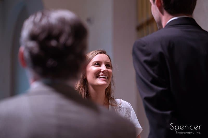 bride smiling at groom at wedding The Chapel in Akron