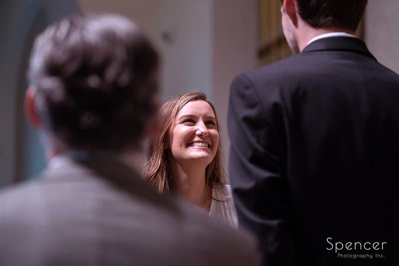 bride laughing during wedding ceremony at The Chapel in Akron