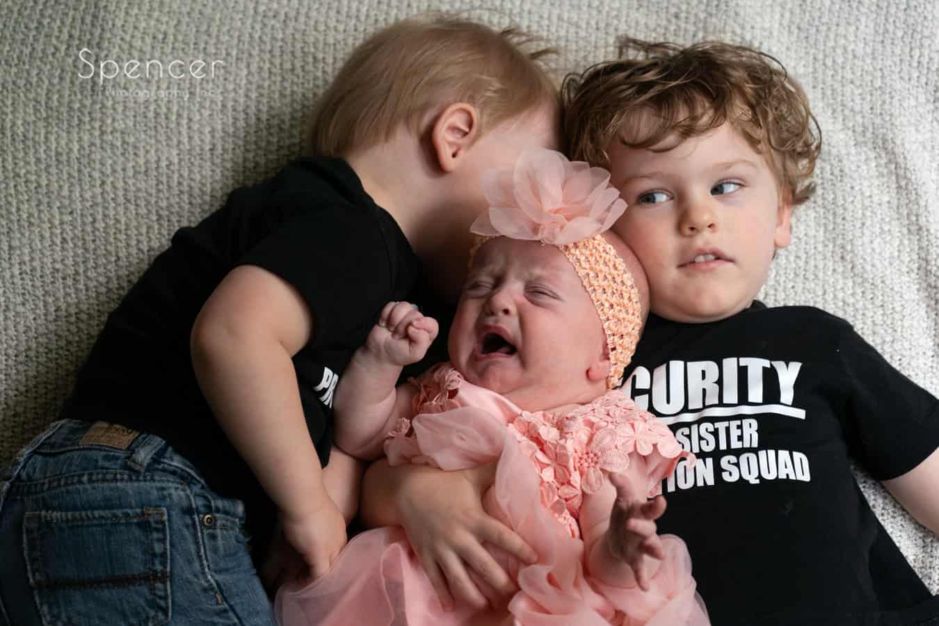 children in family picture with crying baby