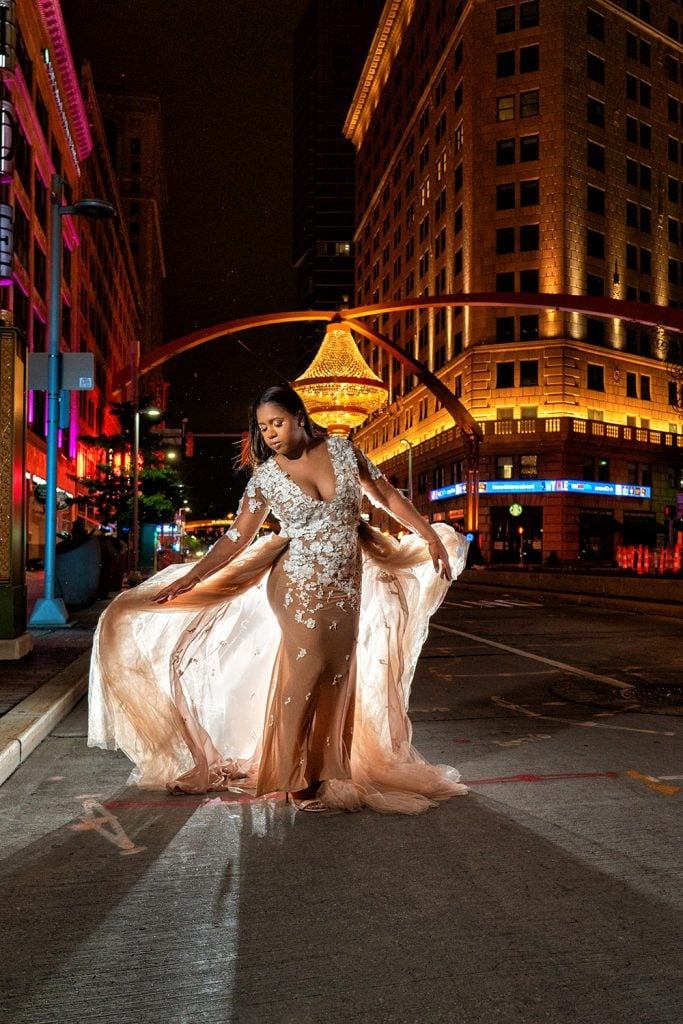 girl in prom dress during senior pictures in Playhouse Square