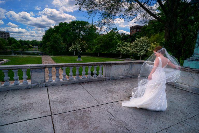 bride adjusting bridal veil at Cleveland Museum of Art