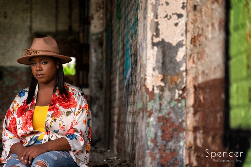 senior girl sitting in downtown Cleveland warehouse