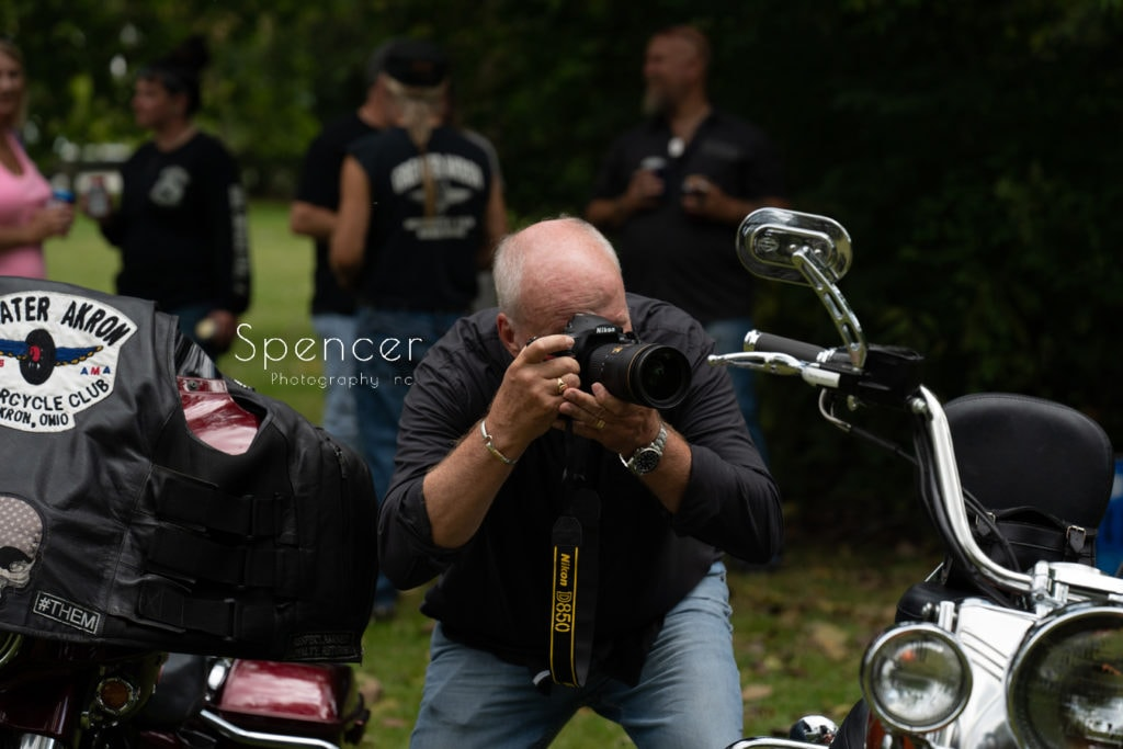 a man taking pictures at wedding ceremony in Merriman Valley