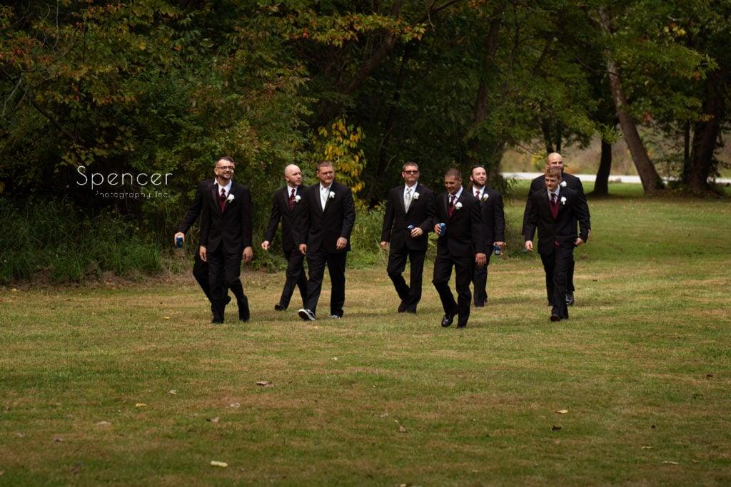groom arriving with groomsmen at wedding in Merriman Valley