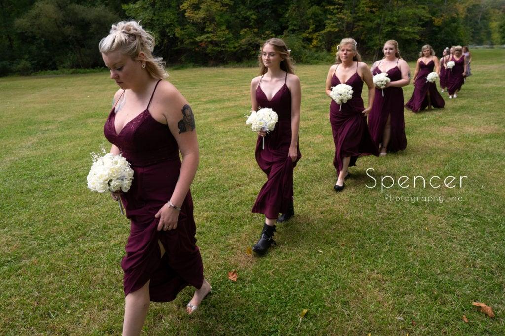bridesmaids walking to akron wedding ceremony