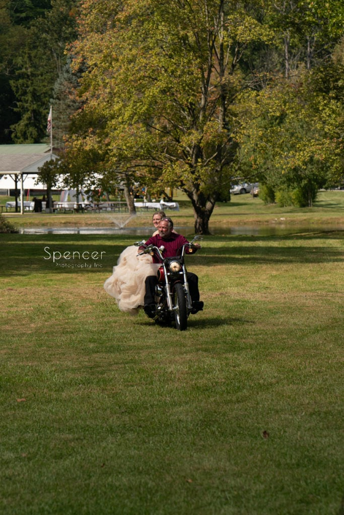 bride riding to akron wedding ceremony on a motorcycle