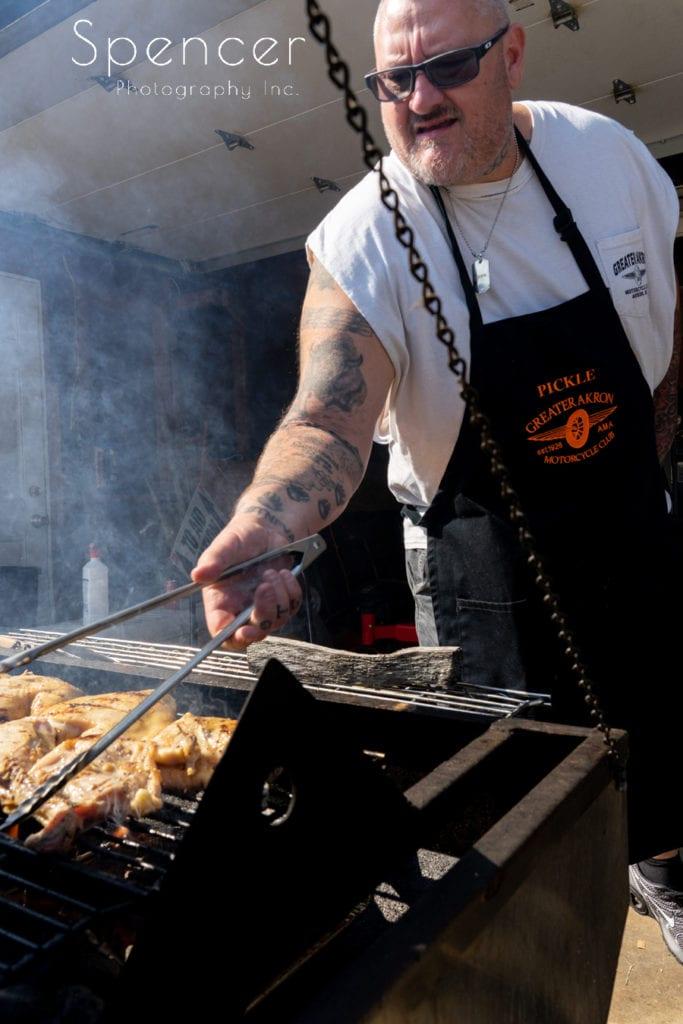 man cooking food at Akron Merriman Valley wedding