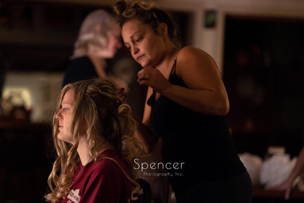 bride getting hair done at Merriman Valley wedding