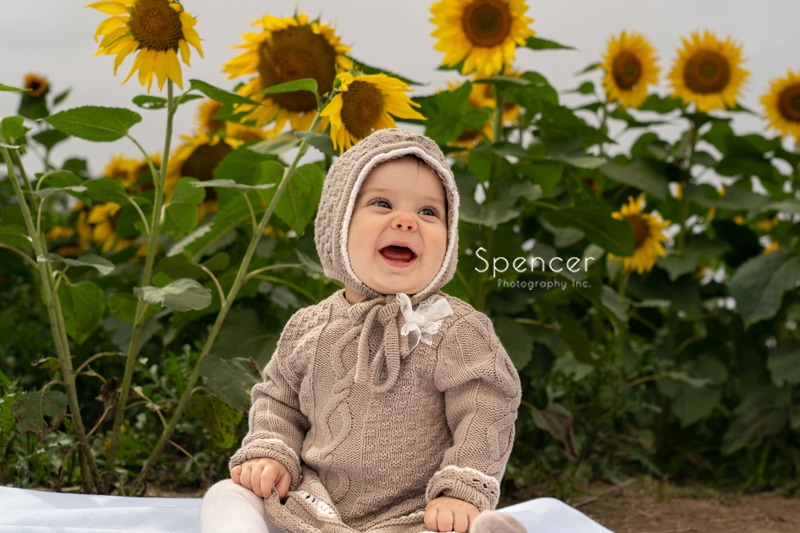 picture of baby in sunflower field