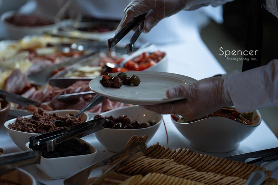 dishing up food at wedding reception at the club at hillbrook