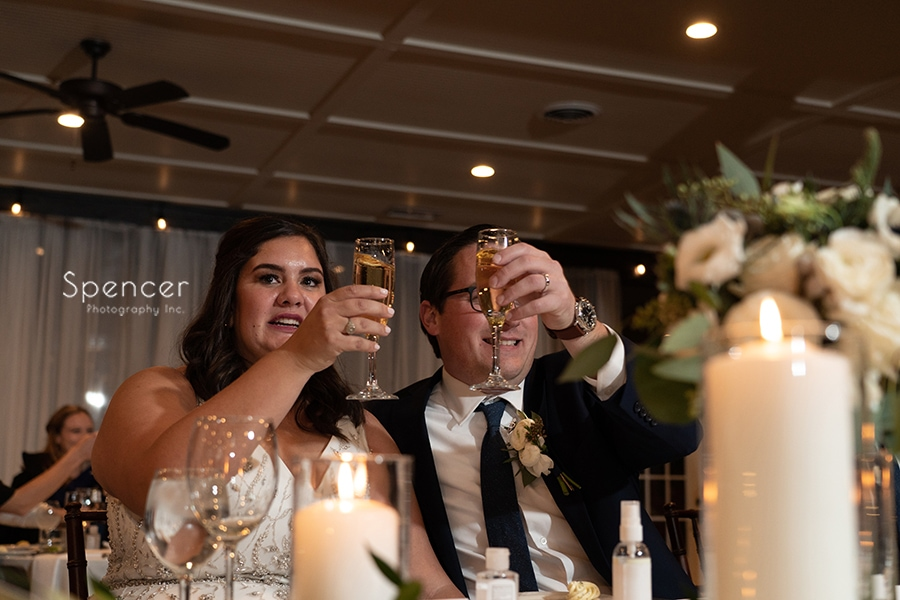 bride and groom raise toast at wedding reception at The Club at Hillbrook